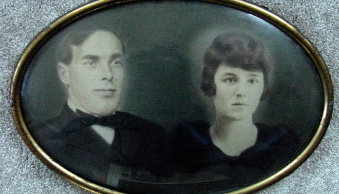 Old glass framed photo of a couple.