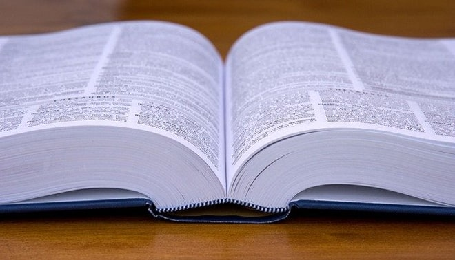 A glossary lying open on a wooden table.