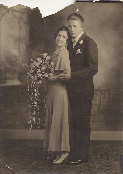 Head to toe 1920s wedding fashion family tree the bride wears an ankle length satin dress with a bias cut and full sleeves the grooms suit likely features a two button front junglespirit Image collections