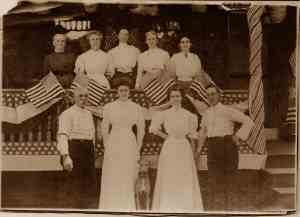 Clothes also indicate a summer get-together in this photo—the women's dresses look like lawn cloth (a light fabric), while the men shed their jackets and rolled up their sleeves.
