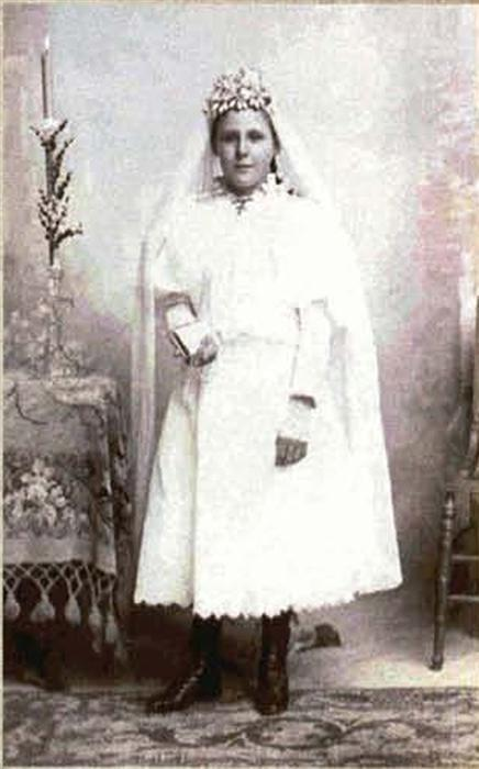 Black and white photo of an ancestor dressed for a first communion.