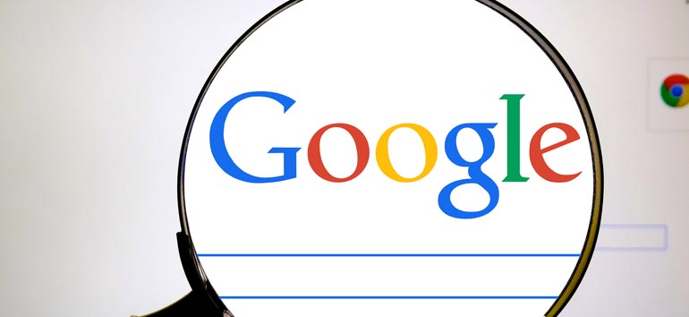 Magnifying glass over the Google search bar.