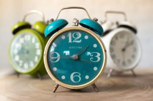 Brightly colored alarm clocks, time