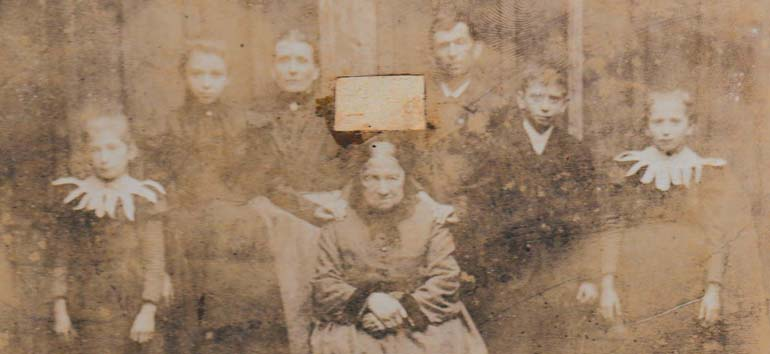 old family photo with face cut out