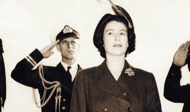 The Duke of Edinburgh salutes his wife, then-Princess Elizabeth, as they step aboard a US Navy ship in 1950