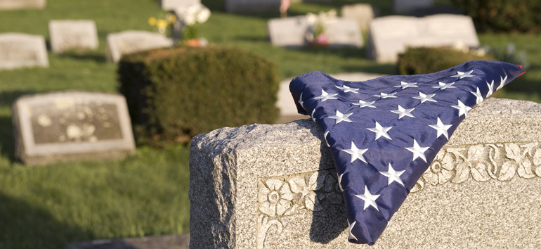 Folded US flag in a military cemetery.