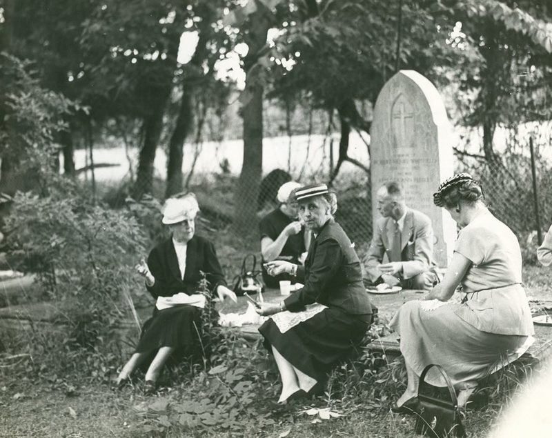 Family having a picnic in a cemetery