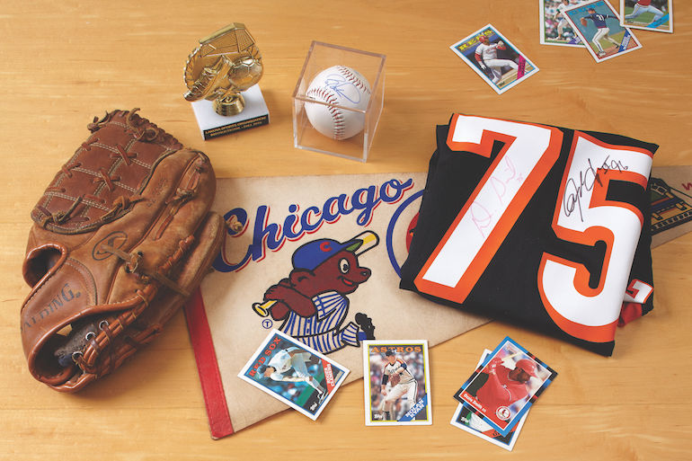 Baseball glove, baseball cards, jersey and other sports memorabilia.