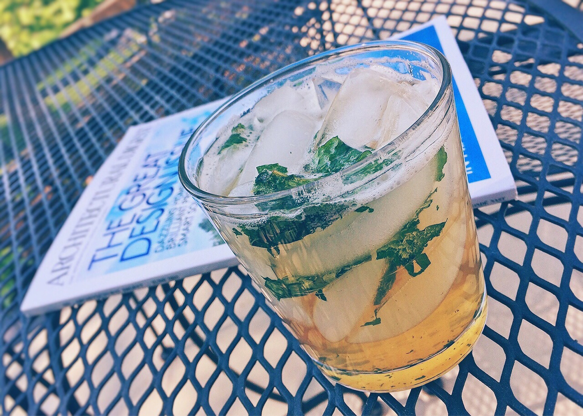 Mint julep cocktail on a patio table.