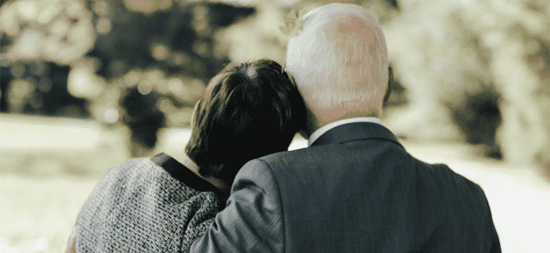 Older couple at a cemetery.