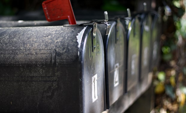 Mailbox with a letter inside.
