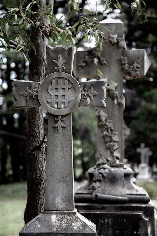 Cross headstone with Christian symbols.