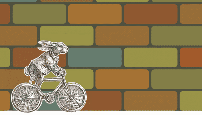 Illustration of Peter Rabbit riding a bicycle past a brick wall.