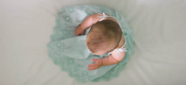 Saving baby items means preserving special outfits.