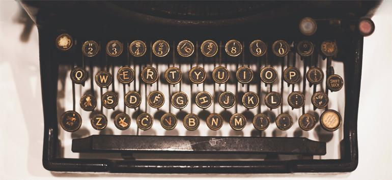 Vintage typewriter on a desk.