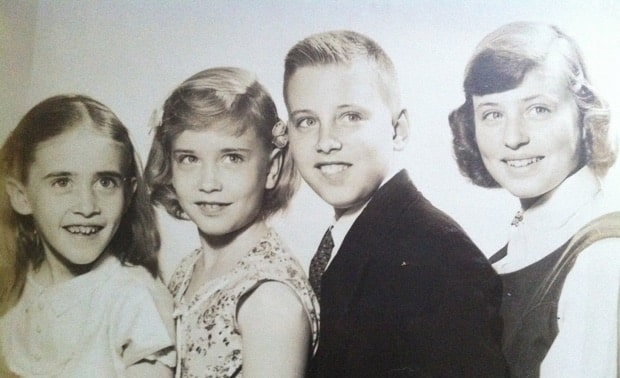 Four children sitting next to each other