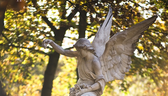 Angel tombstone in a cemetery.