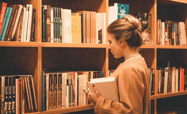 Woman browsing in a bookstore.