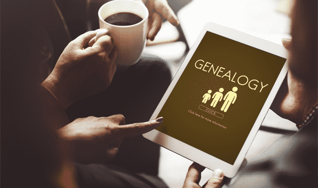 People sitting and having coffee while looking at a free genealogy website on an iPad.