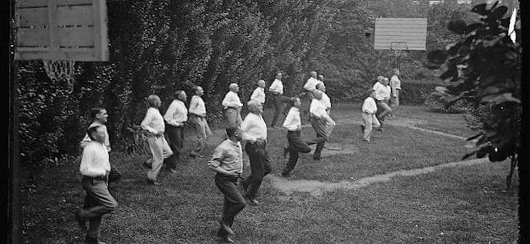 Vintage photo of a group of men exercising.