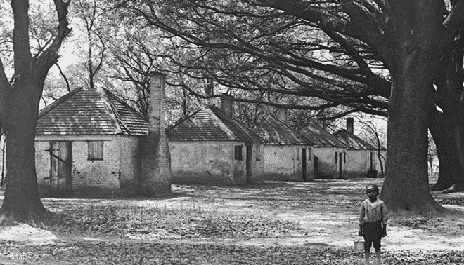 Black and white photo of old slave housing.