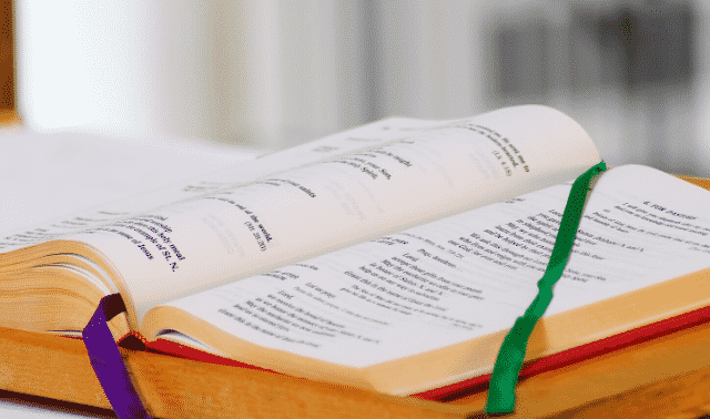 Religious text lying on a table.