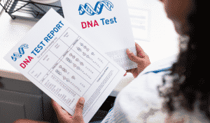 Woman looking at her DNA test results so she can use them in her genealogy research.