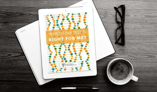 An iPad laying on top of an open book, showing the Which DNA Test is Right for Me? ebook.