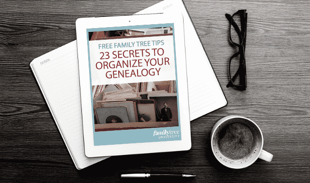 An iPad laying on top of an open book, showing the Find Your Ancestors in the Organize Your Genealogy ebook.