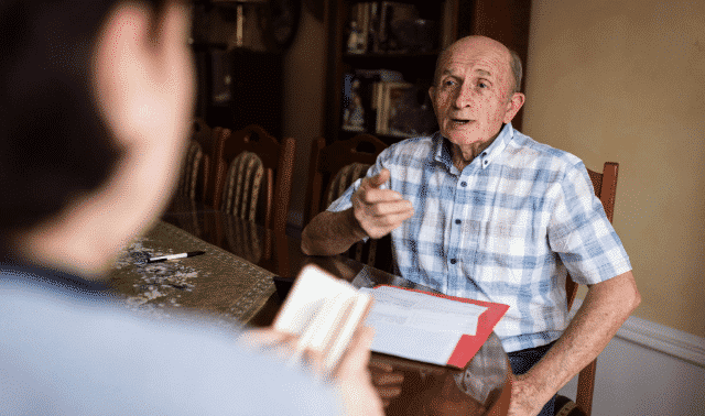 Person asking interview questions to an elderly family member.