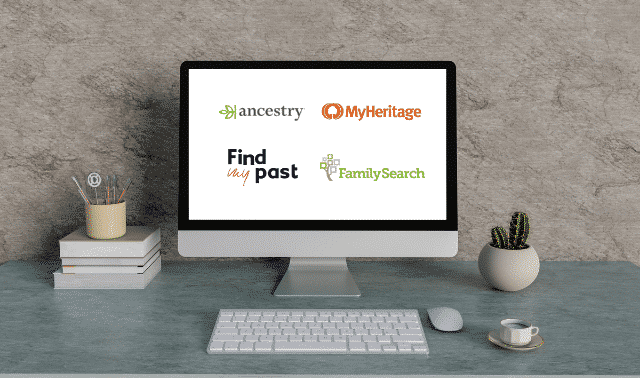 Computer monitor showing Ancestry, MyHeritage, FamilySearch and FindMyPast on screen