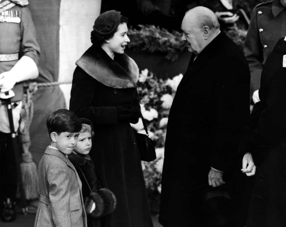 Queen Elizabeth speaking to Winston Churchill in 1953. The young Prince Charles and Princess Anne are also present.