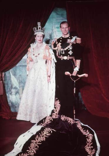 Queen Elizabeth II and Prince Phillip pose after the Queen's coronation. The Queen wears St. Edward's Crown and her coronation dress; Phillip wears his military uniform.
