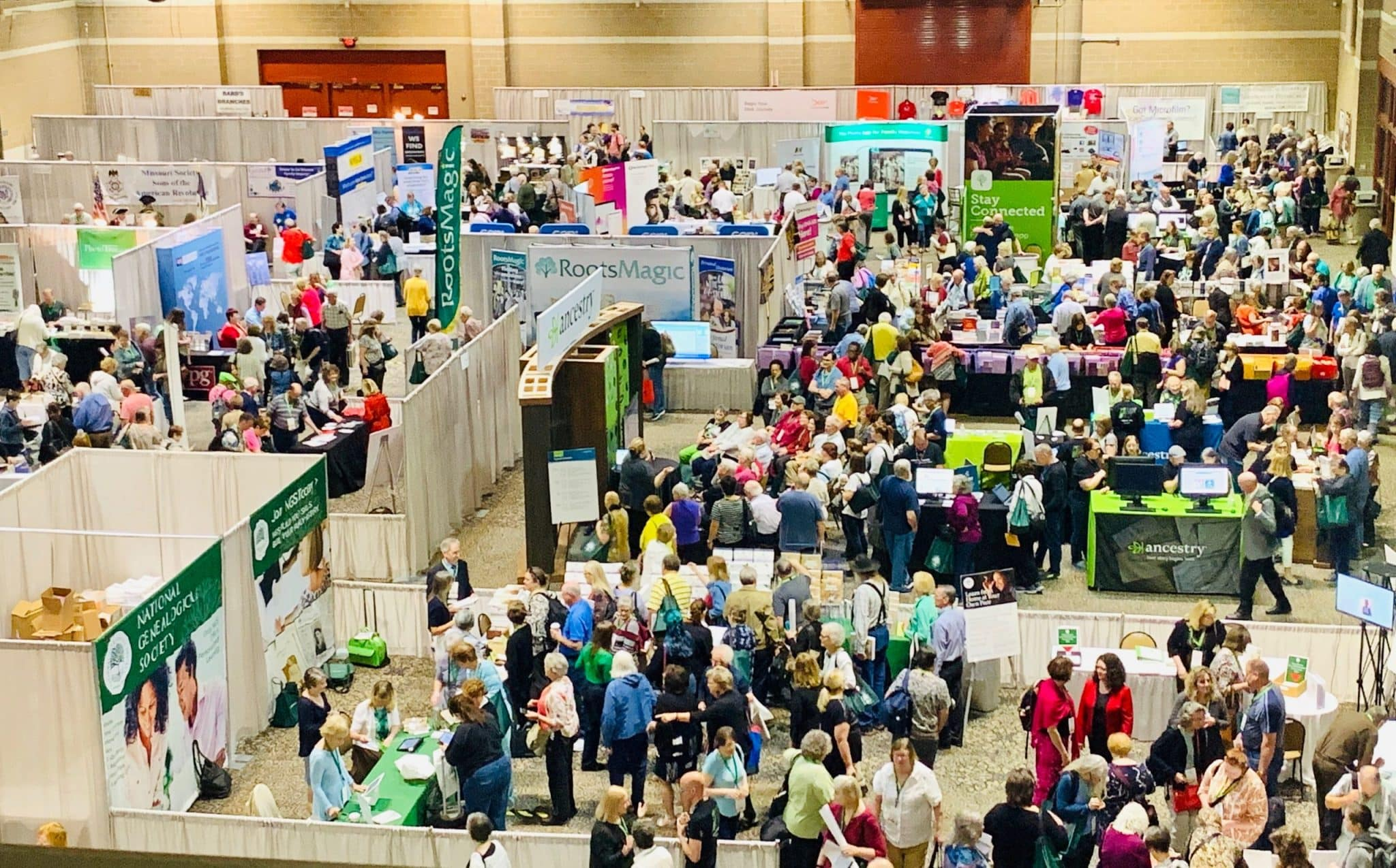 Overhead view of booths at a genealogy conference.