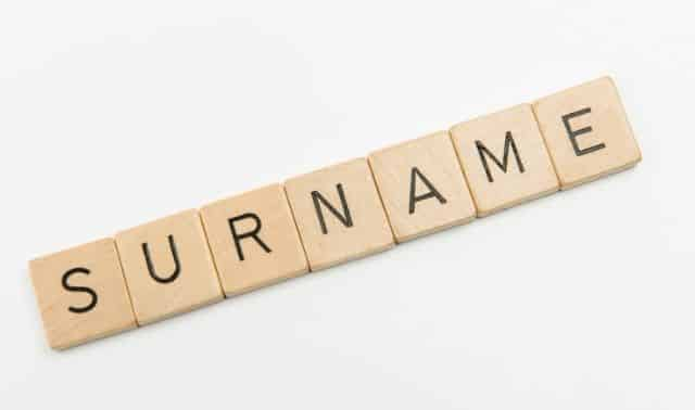 "Wooden letter tiles spelling out ""surname"""