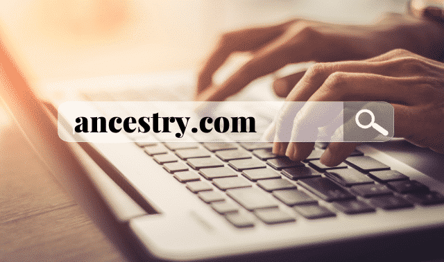 Ancestry.com in search bar with fingers typing on computer keyboard in background