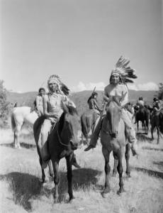 Native American men on horses